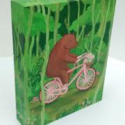 botanist-bear-on-a-bicycle
